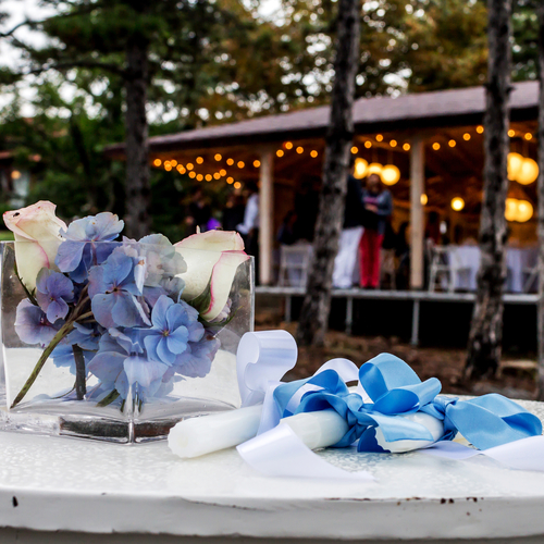 Flowers and candles prepared for the newlyweds during outdoor wedding celebration